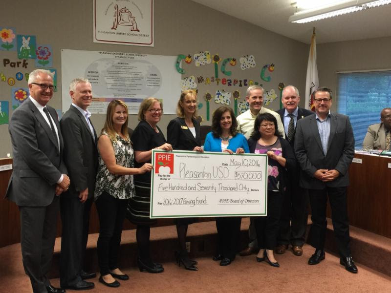 PPIE presenting Giving Fund check to PUSD School Board